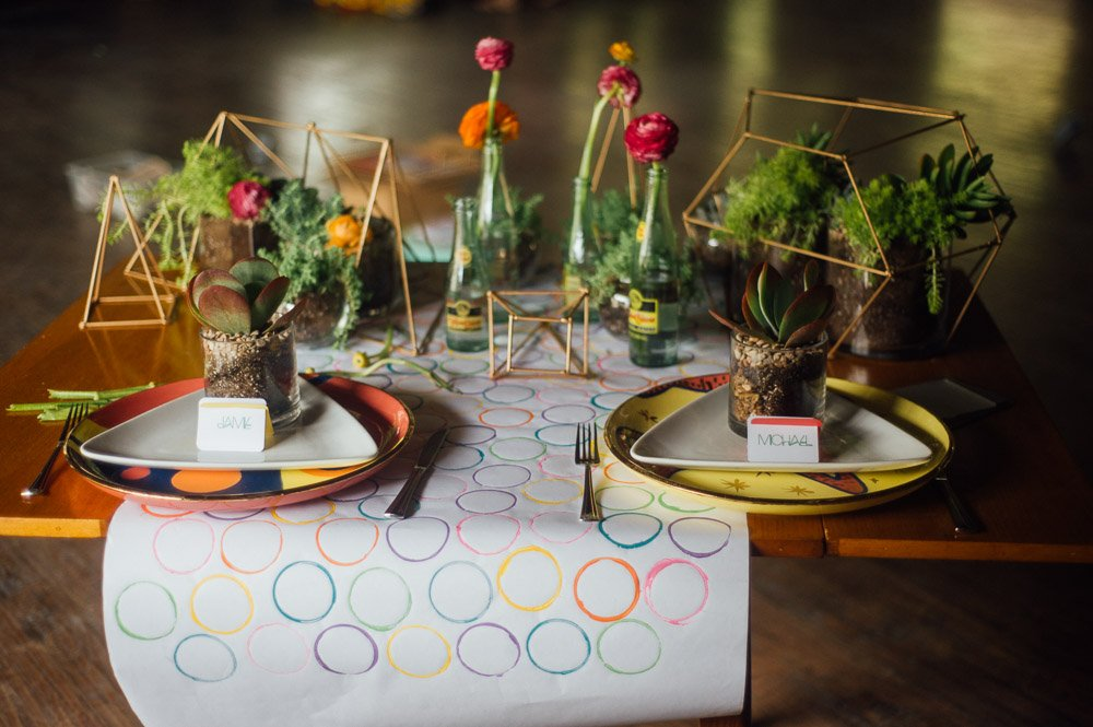 sweetheart table settings at a gold and brightly colored geo modern wedding styled shoot