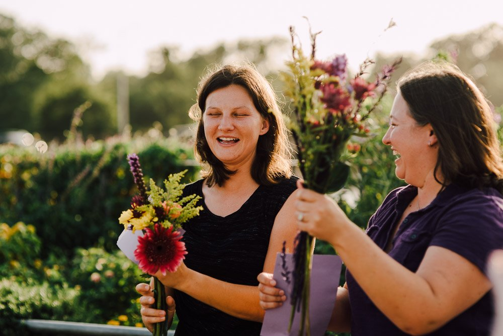 happy brides smile at their pop up wedding after SCOTUS ruling