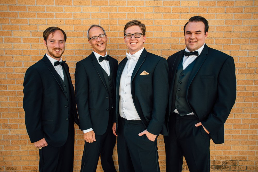 groomsmen in black tie for downtown wedding
