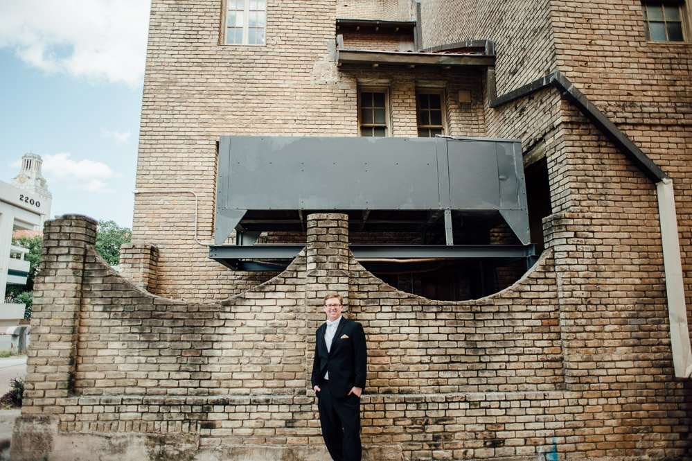 groom photographed downtown austin wedding, university of texas wedding photography