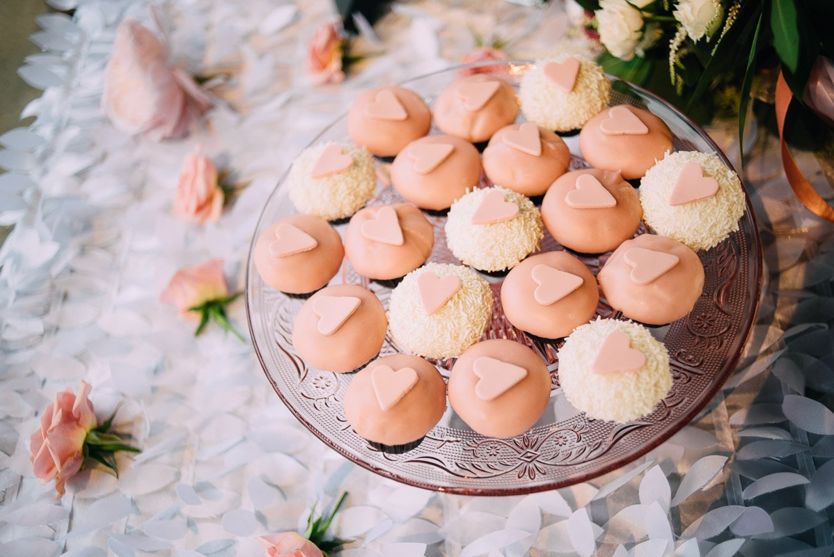 miniature pink and white cupcake display on a vintage glass cake tray, romantic pink and white wedding decor
