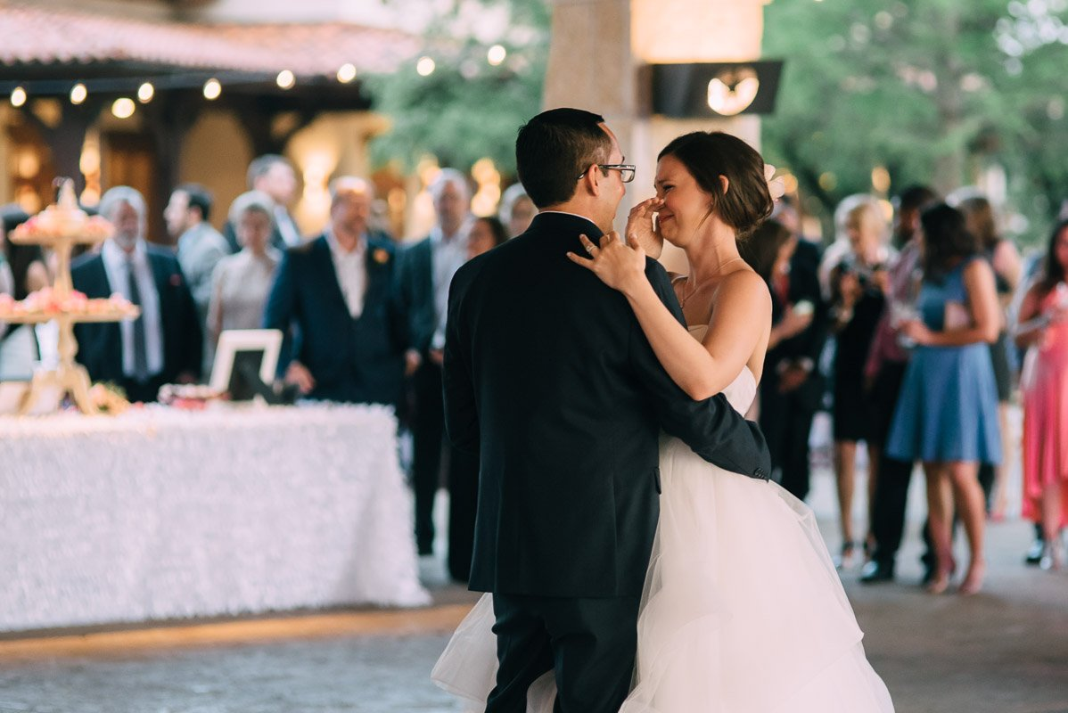 emotional bride during first dance at a spring wedding in austin texas