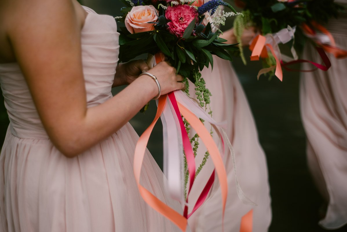pink bridesmaids with ribbon bouquets at ut golf club austin spring wedding