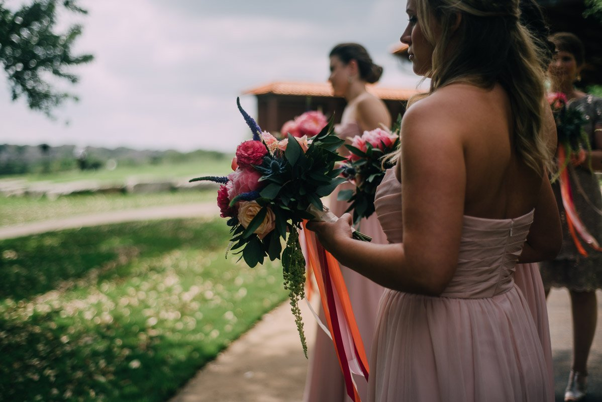 bridesmaid holding a pink peony bouquet
