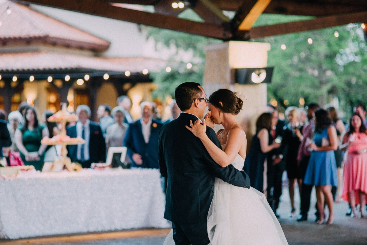 documentarian austin wedding photographer under 3k, first dance at UT Golf club wedding, pink and gold romantic spring wedding in austin texas, wedding photographer in austin texas
