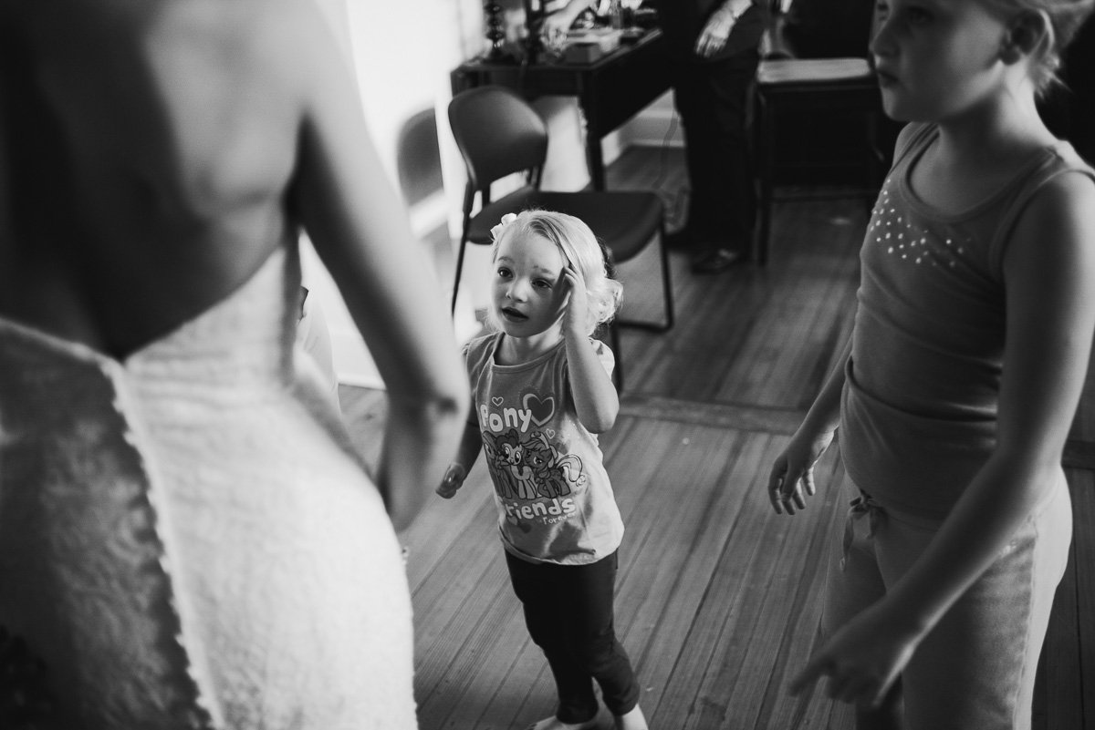 flower girl being cute in the bride's getting ready room