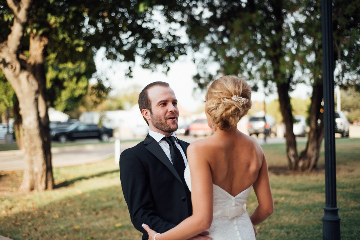 groom's reaction to seeing bride for the first time during a first look, best first look ideas, fort worth wedding photographer,