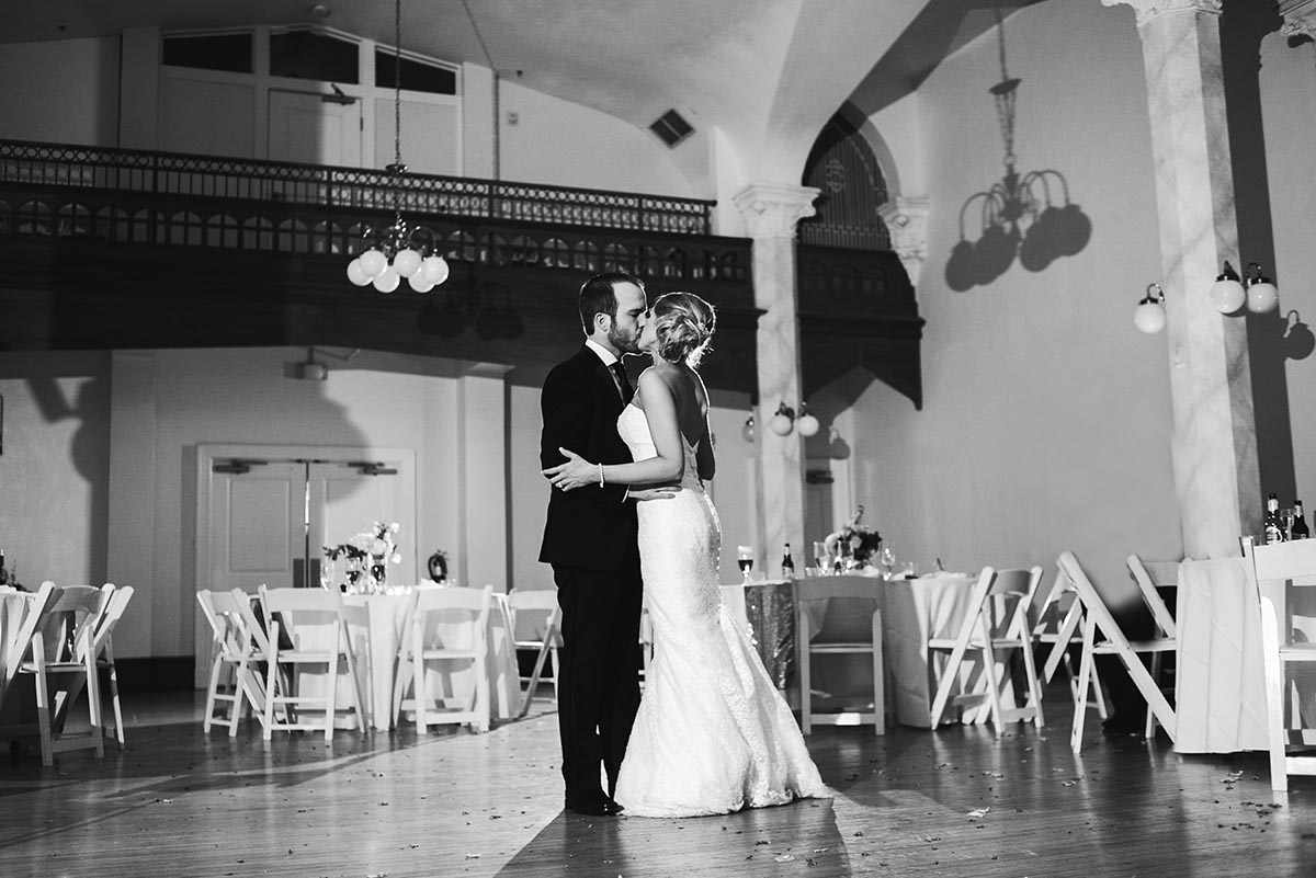 the couple shares a private last dance alone after their gold and white black tie wedding at the victory arts center in fort worth texas