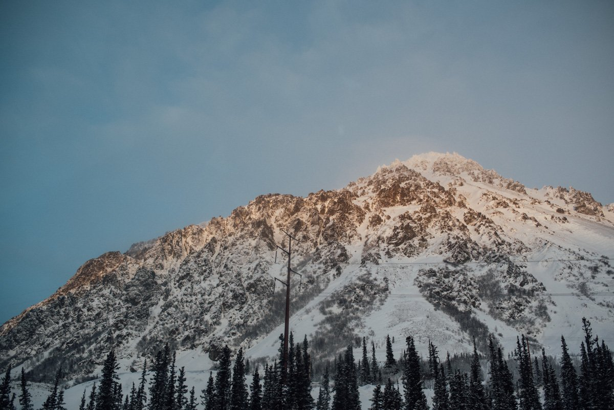 travel photographer in anchorage alaska, sunset on a mountain in alaska in december
