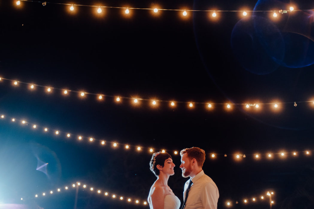 le san michele wedding photographer, austin wedding photographer, spring wedding at le san michele, string lights during first dance at le san michele austin texas, texas wedding photography in austin hill country, hill country wedding photographer