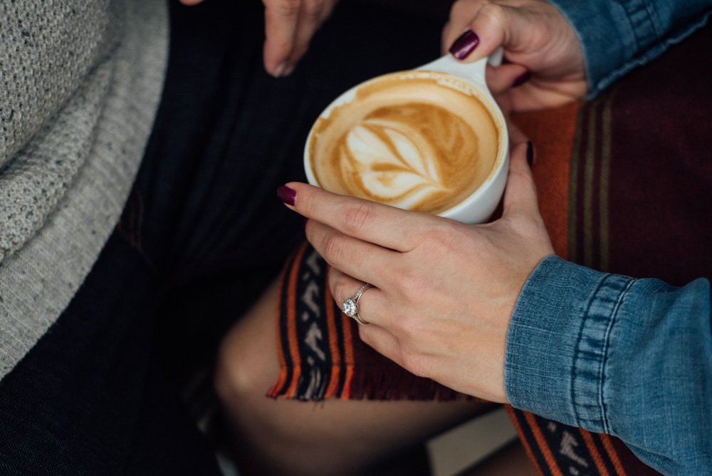 grab a latte at local coffee during your engagement photos at the pearl brewery center in san antonio, lifestyle engagement photographs at pearl brewery in san antonio