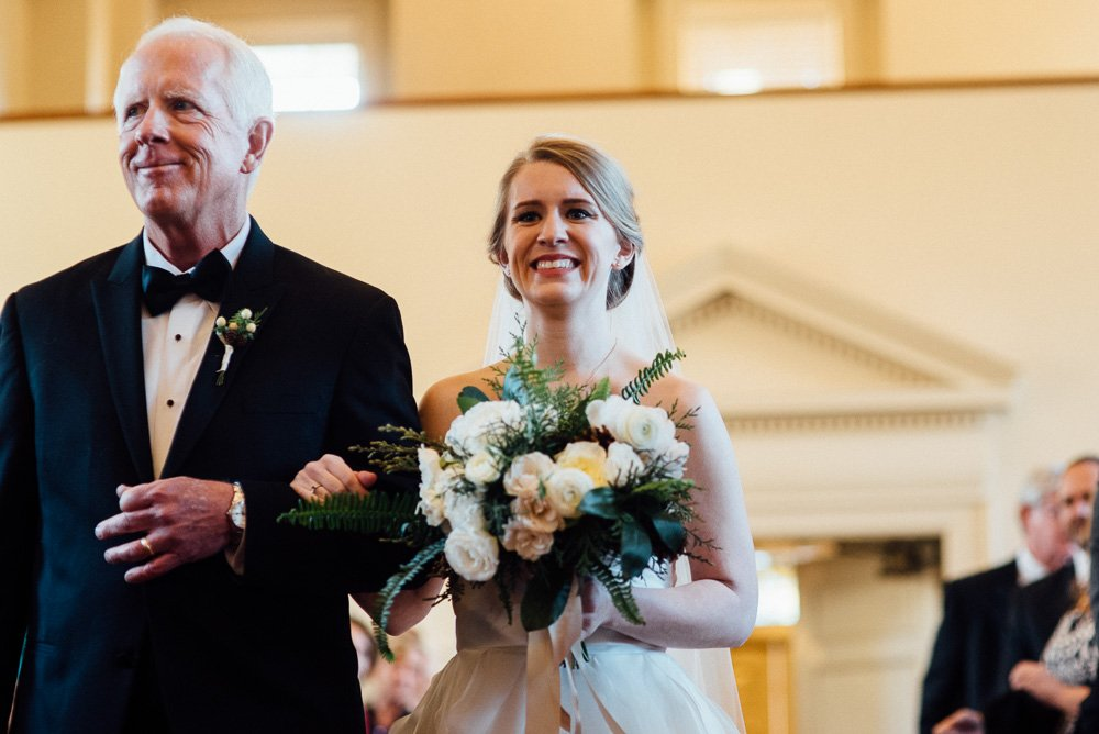 timeless winter white wedding at robert carr chapel in fort worth, elegant wedding photography fort worth, fort worth wedding photographer at robert carr chapel, bride walks down the aisle with her dad at robert carr chapel in tcu