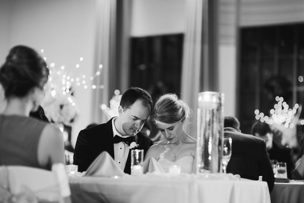 bride and groom praying at wedding reception fort worth, classic winter wedding in fort worth texas, editorial fort worth wedding photographer, bass concert hall wedding reception