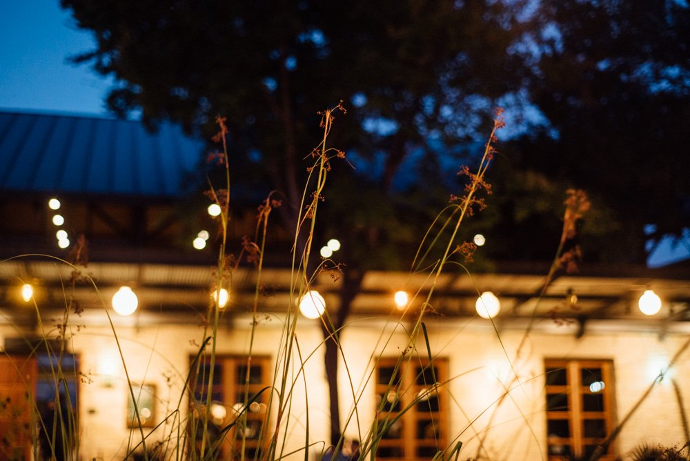 night photos of lady bird johnson wildflower center, wildflower center weddings, natural light wedding photography in austin, austin wedding photographer, unique wedding photography ideas austin