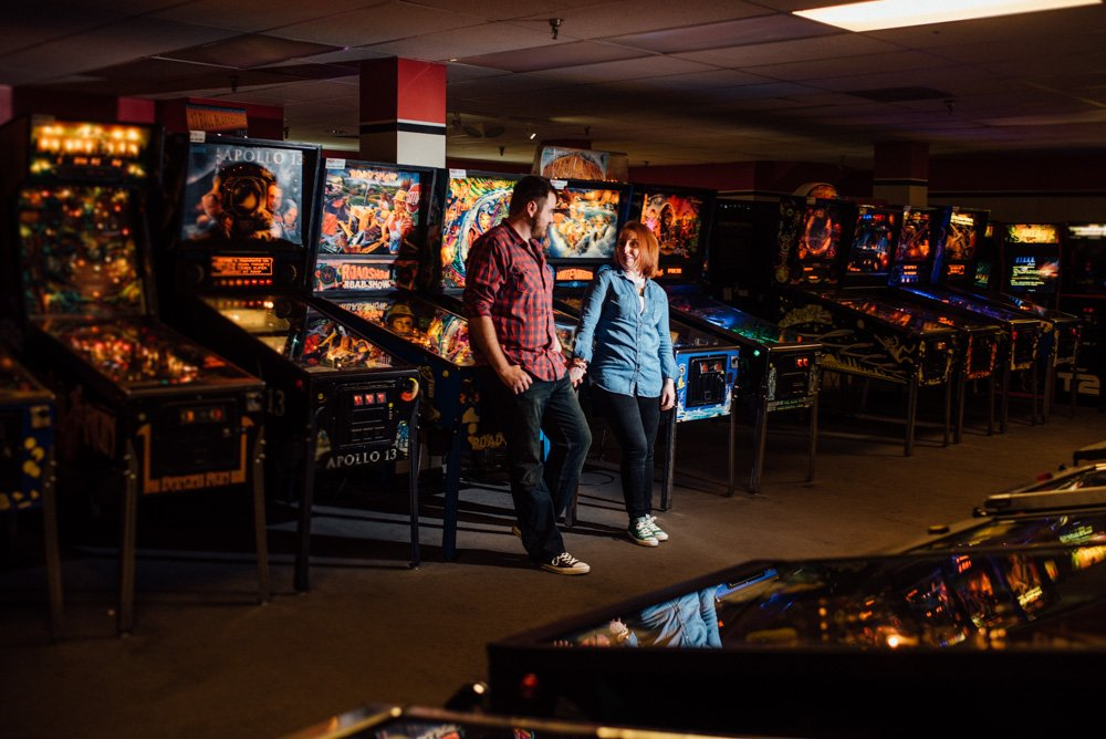 unique and non-traditional engagement session at pinballz arcade in austin texas,