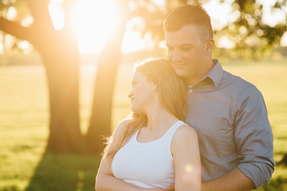 summer engagement photographs with sun flare, dallas engagement photo spots, natural light engagement photographer in fort worth