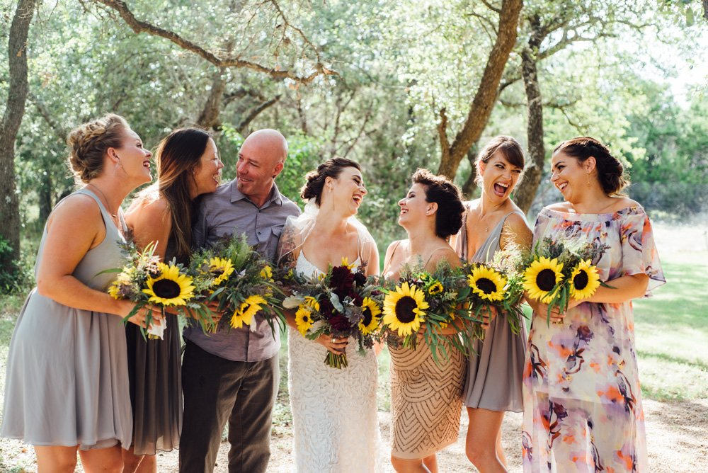 bride and maids laughing holding bouquets at an outdoor wedding in austin texas