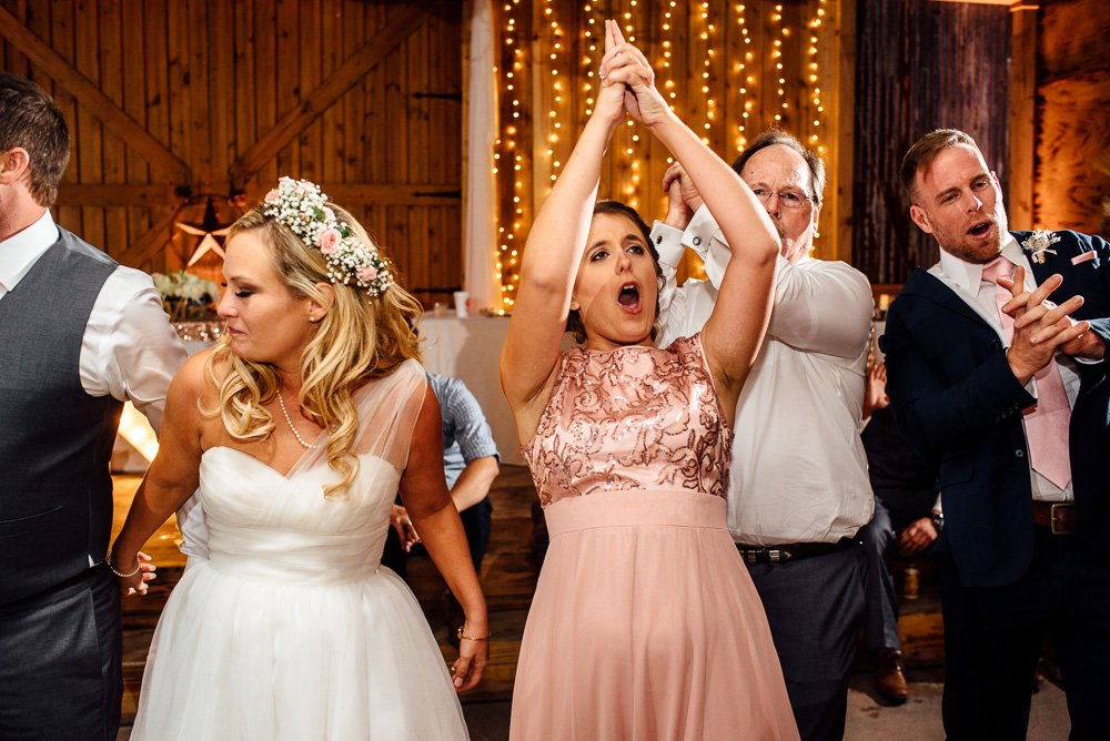 bridesmaid does the aggie war hymn at a rustic ranch wedding in conroe