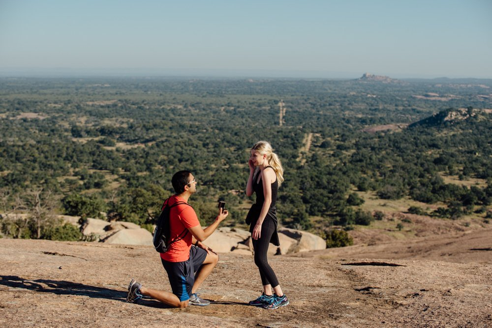 popping the question on top of enchanted rock at sunrise