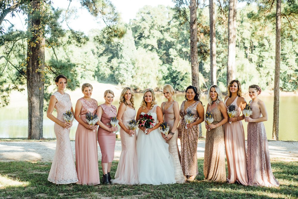 pink mismatched dress bridesmaids at a rustic conroe wedding