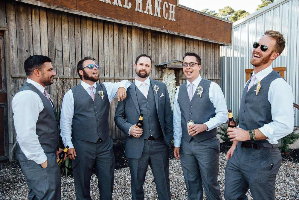 candid of groomsmen hanging out at rustic houston wedding