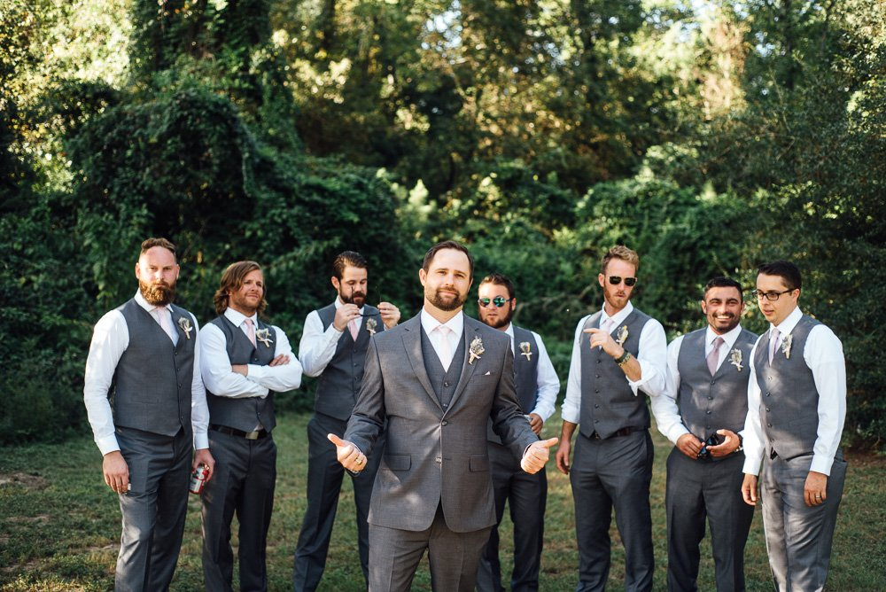 candid groomsmen in grey suits at pine lake ranch