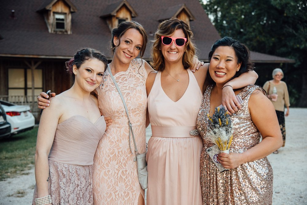 pink bridesmaids in mismatched dresses