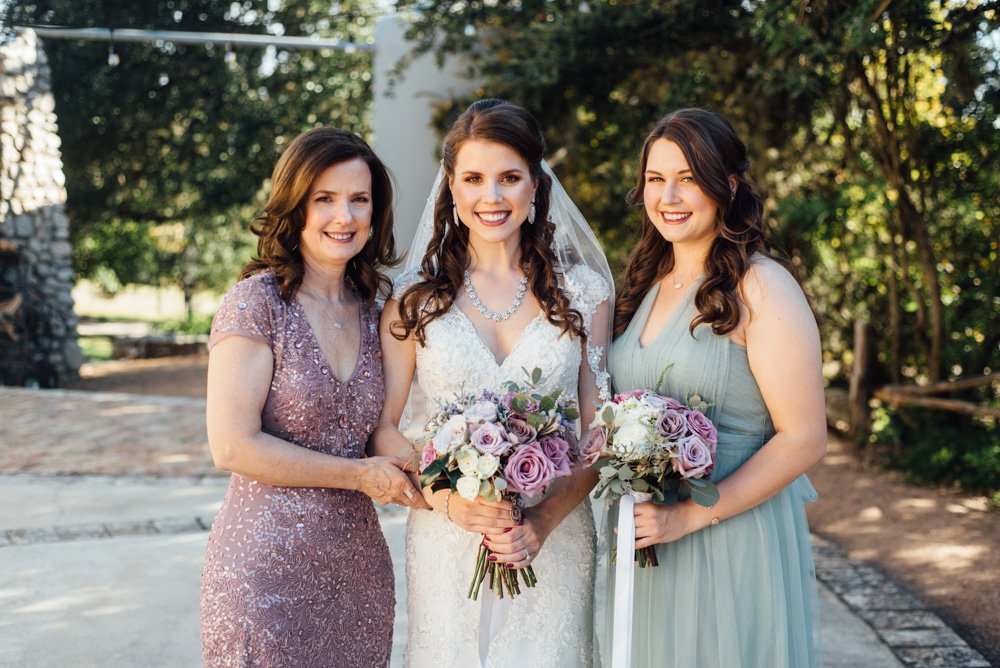 a mother and her daughters pose on the bride's wedding day in san antonio