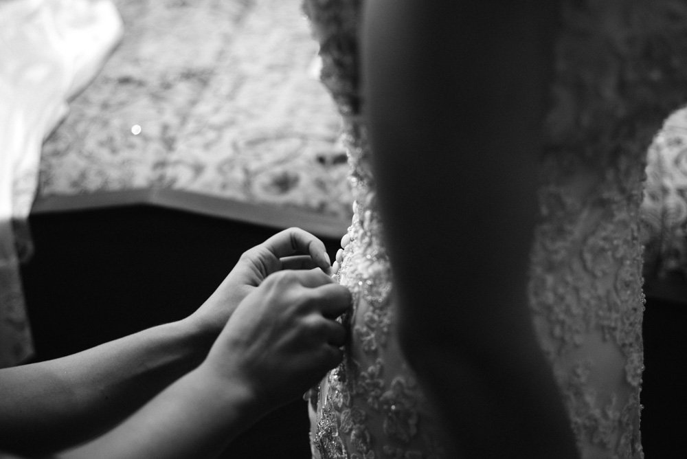 bride getting dressed detail photograph
