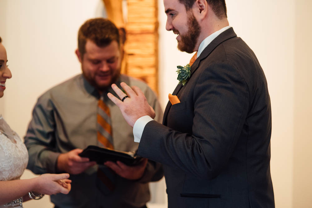 wedding ceremony inside chapel at heritage house