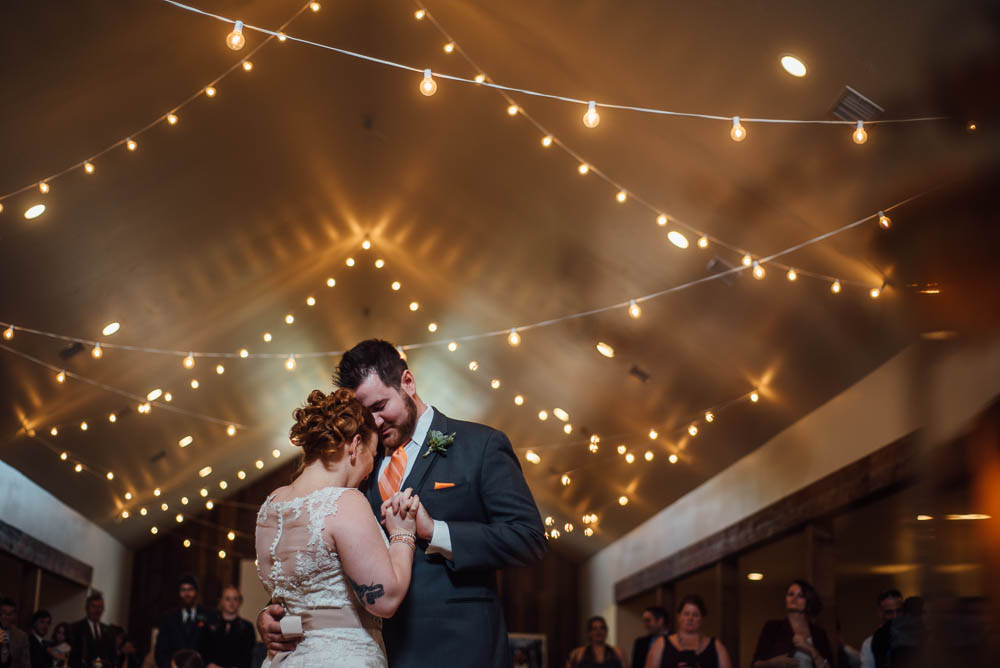first dance under the string lights, heritage house brunch wedding, tattooed bride and groom first dance