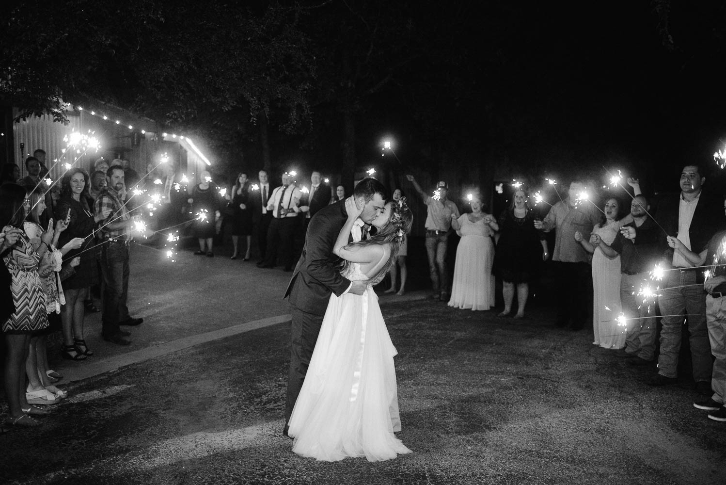 sparkler exit with bride and groom kissing at the end