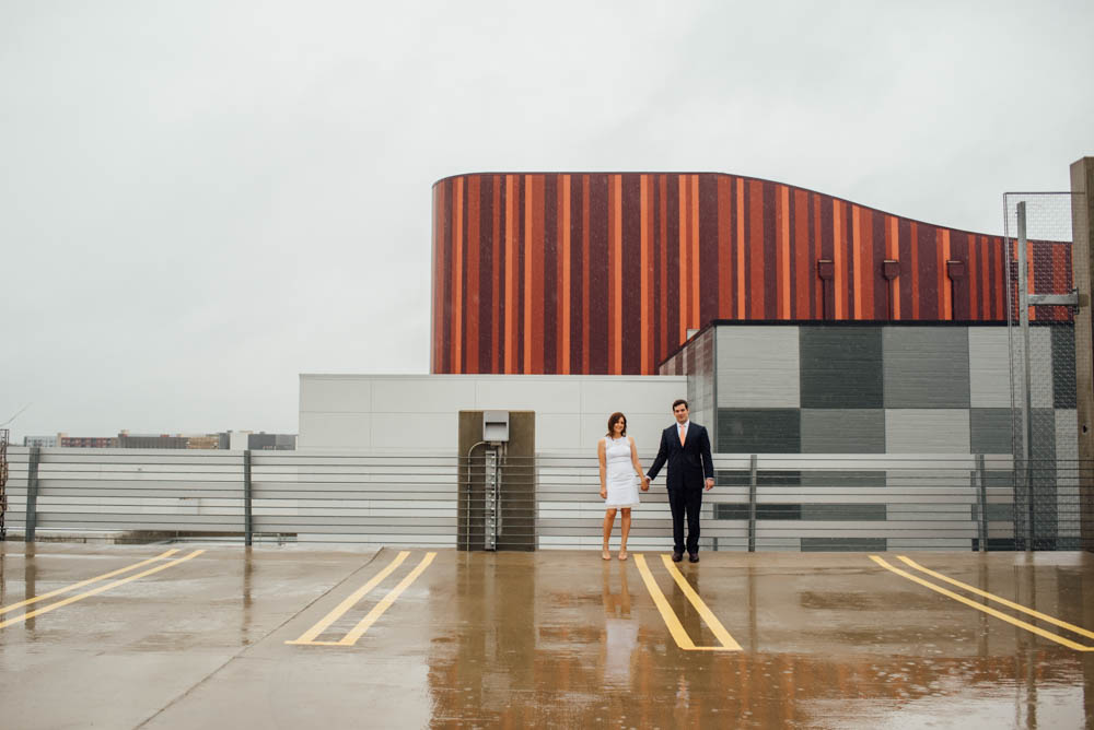 mueller parking garage elopement portraits in the rain, urban elopement photographs during a rainy afternoon in austin