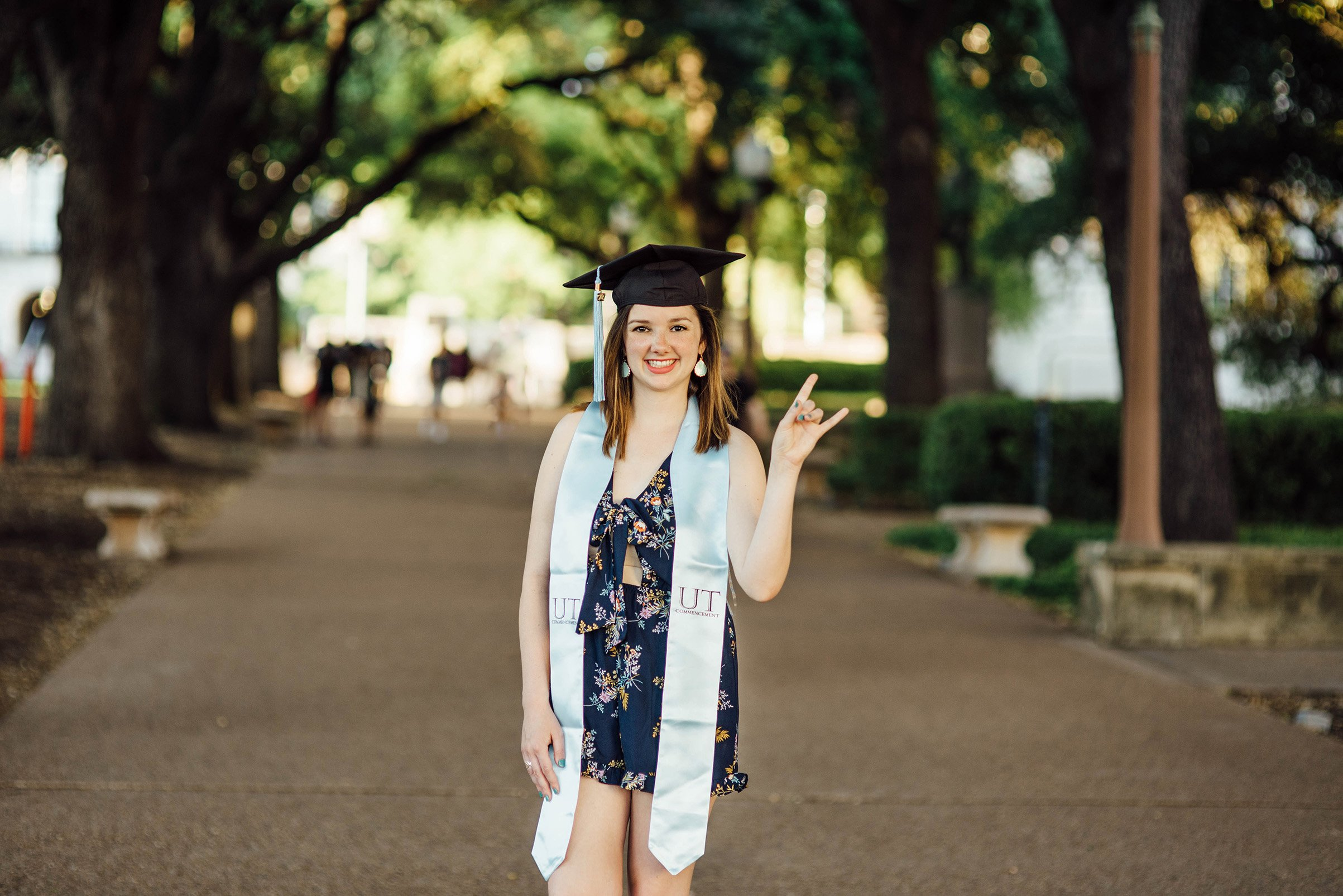 UT Senior portraits on the main mall with cap and gown