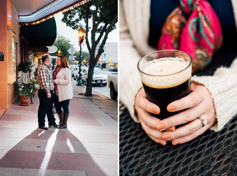 a cute couple poses under the marquee at a downtown movie theater and drinks dark beers on patios in a fall engagement session in downtown cibolo texas