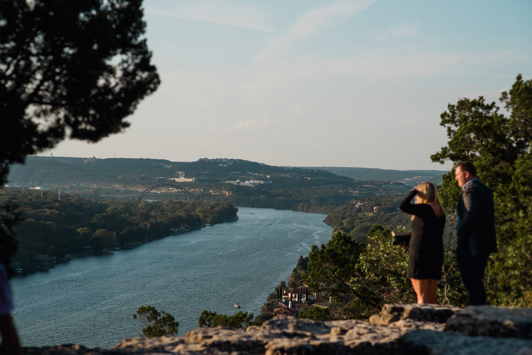 couple overlooks lake austin from mt. bonnell before their proposal