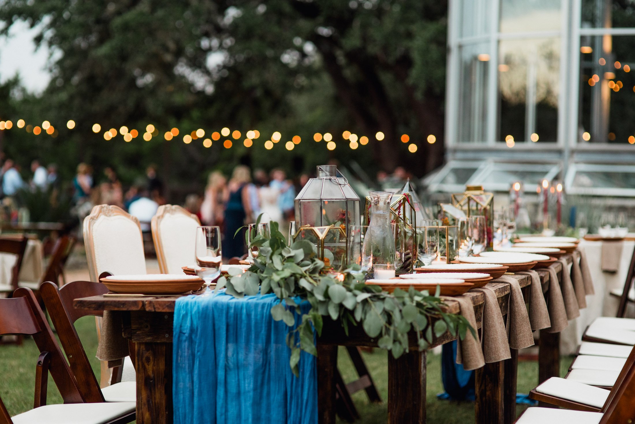 modern glass and cerulean blue table decor at an outdoor wedding in austin texas