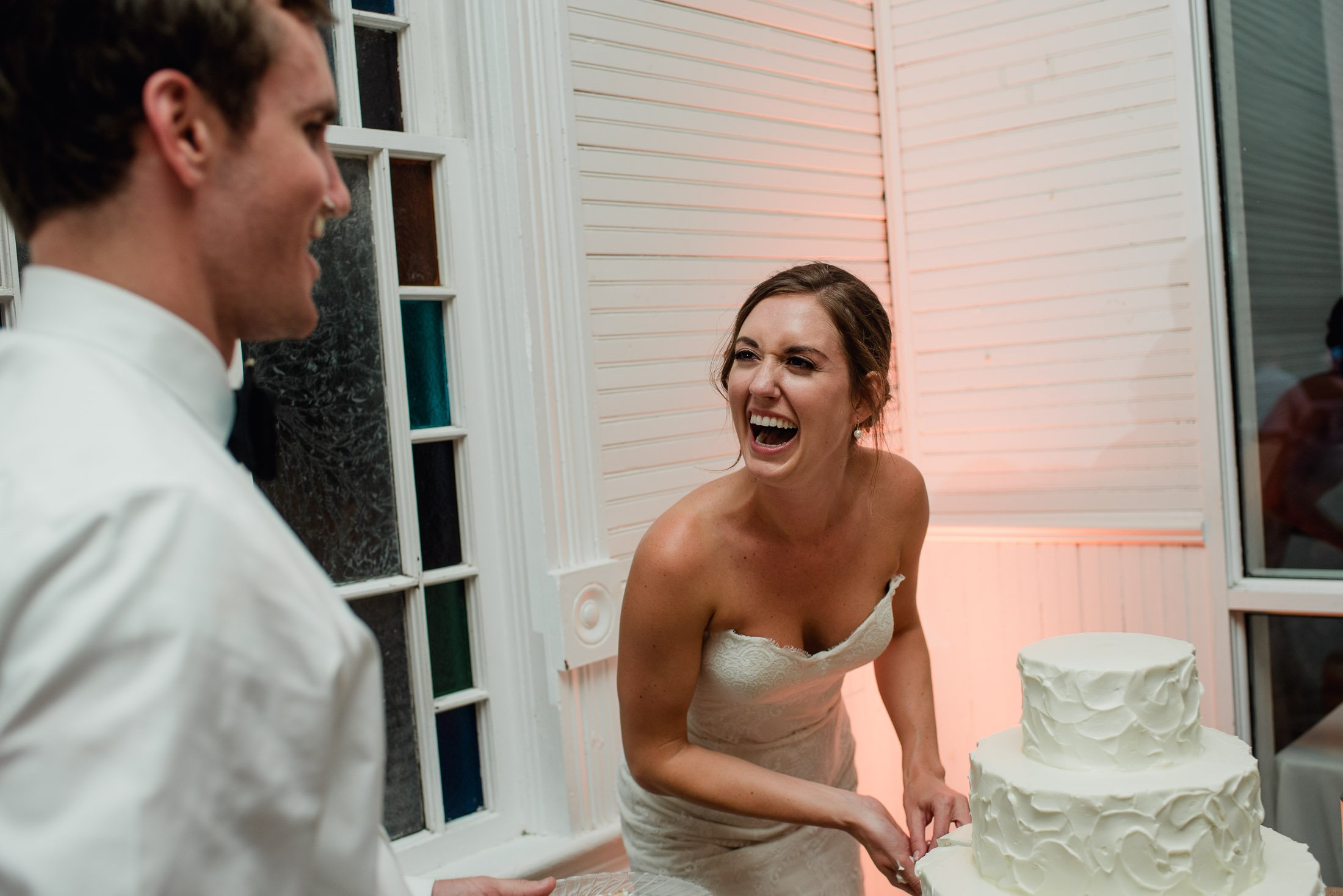 bride laughing hysterically at her mercury hall wedding