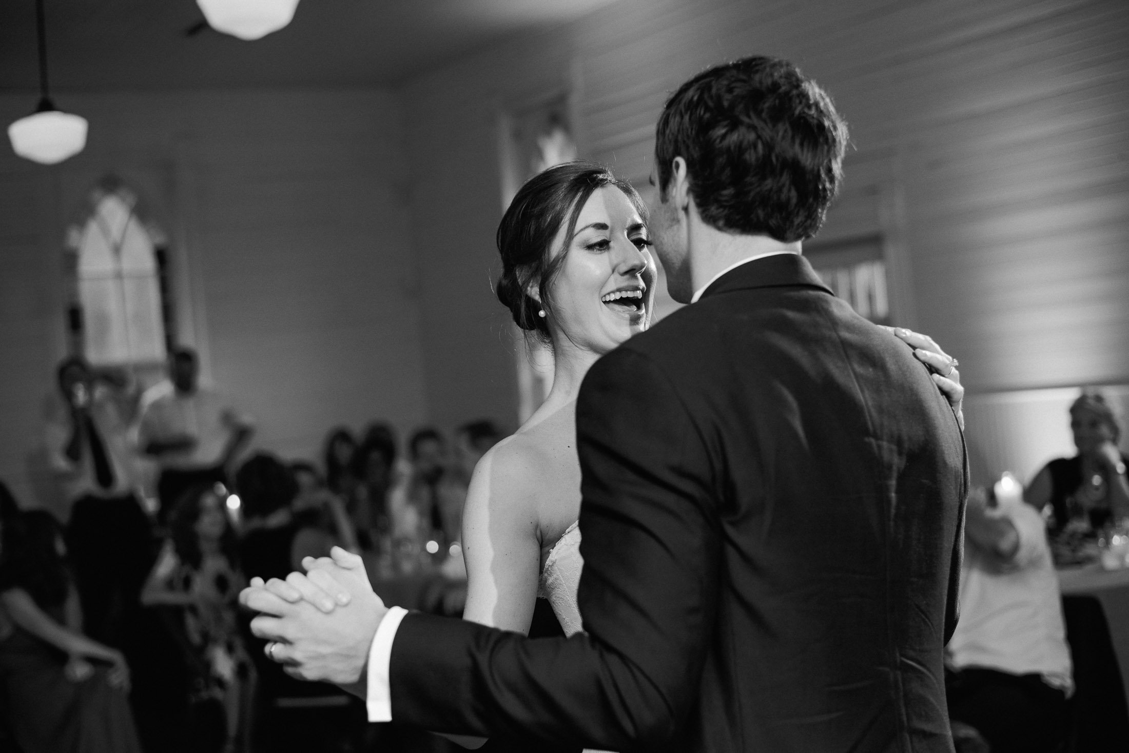 beautiful first dance black and white candid moment during a couple's first dance as husband and wife at a small white house venue in Austin Texas