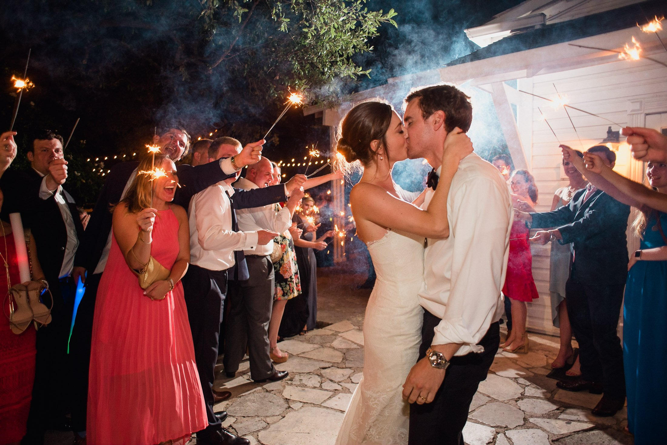 bride and groom kiss during a sparkler exit at mercury hall in austin