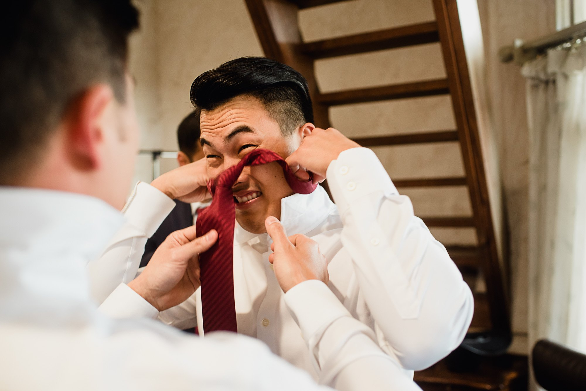 funny face groom with tie on head