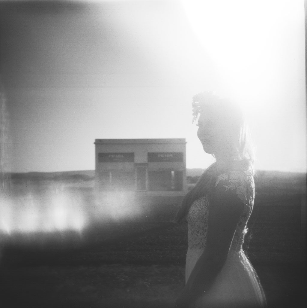 prada marfa portraits in black and white with a bohemian bride