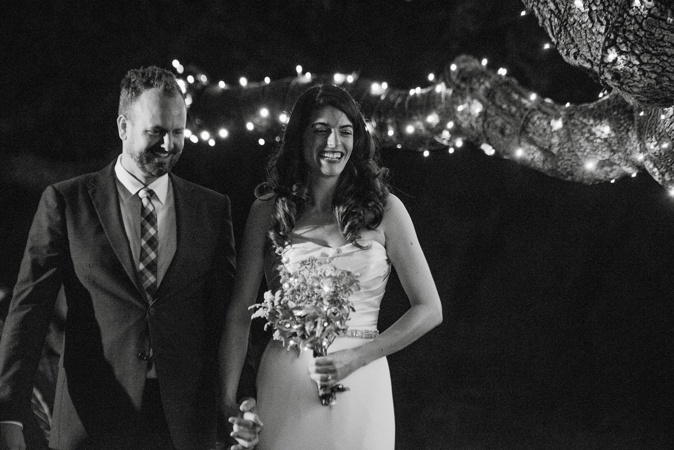 black and white photographs at a night time wedding at the austin texas wildflower center