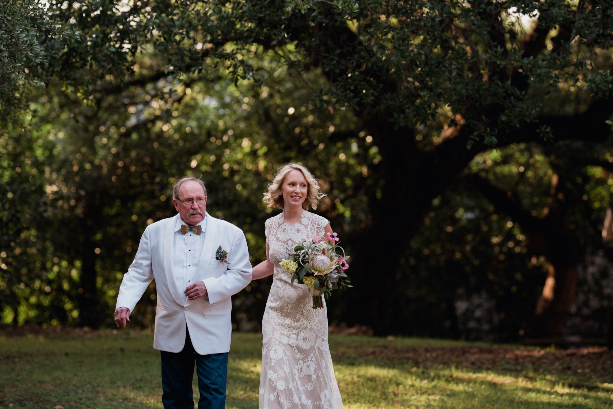 a bride and her dad walk together at a mercury hall wedding in austin texas