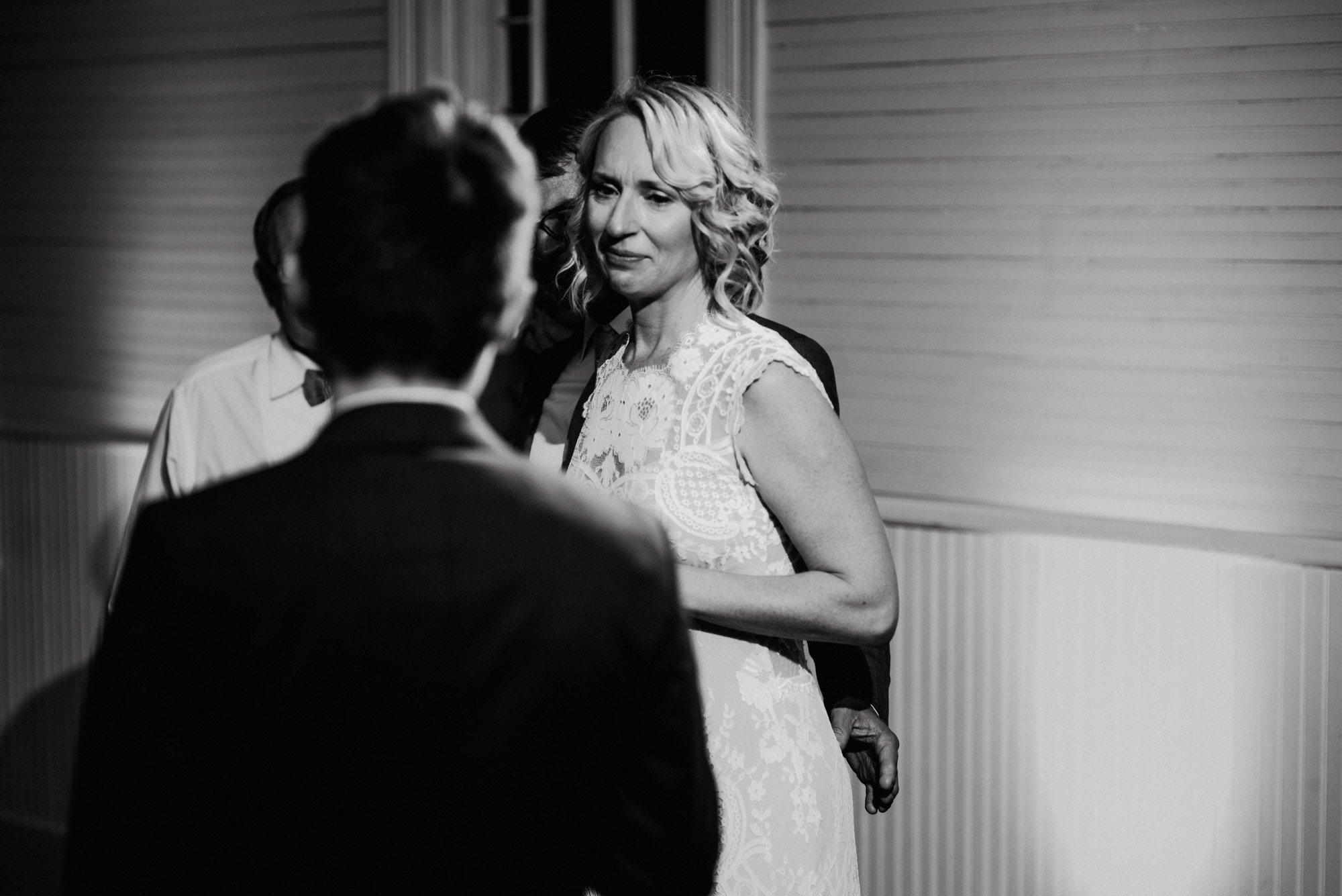 austin wedding photographer, emotional toast photographs in black and white, emotional wedding photographs, photojournalistic wedding photography in austin, austin wedding photography