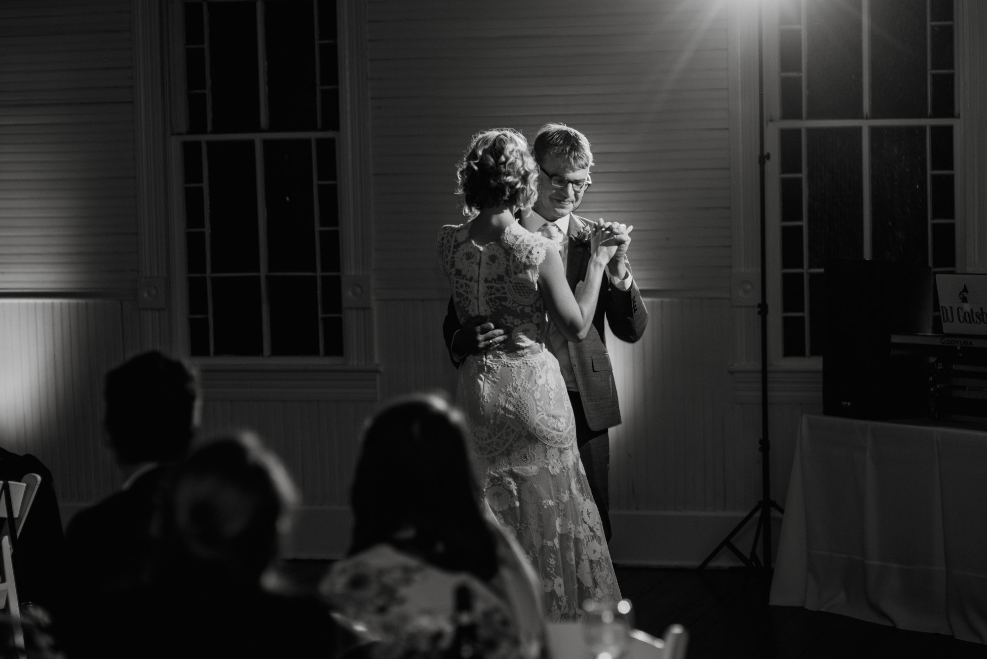 first dance together under the spotlight at a small wedding venue in south austin