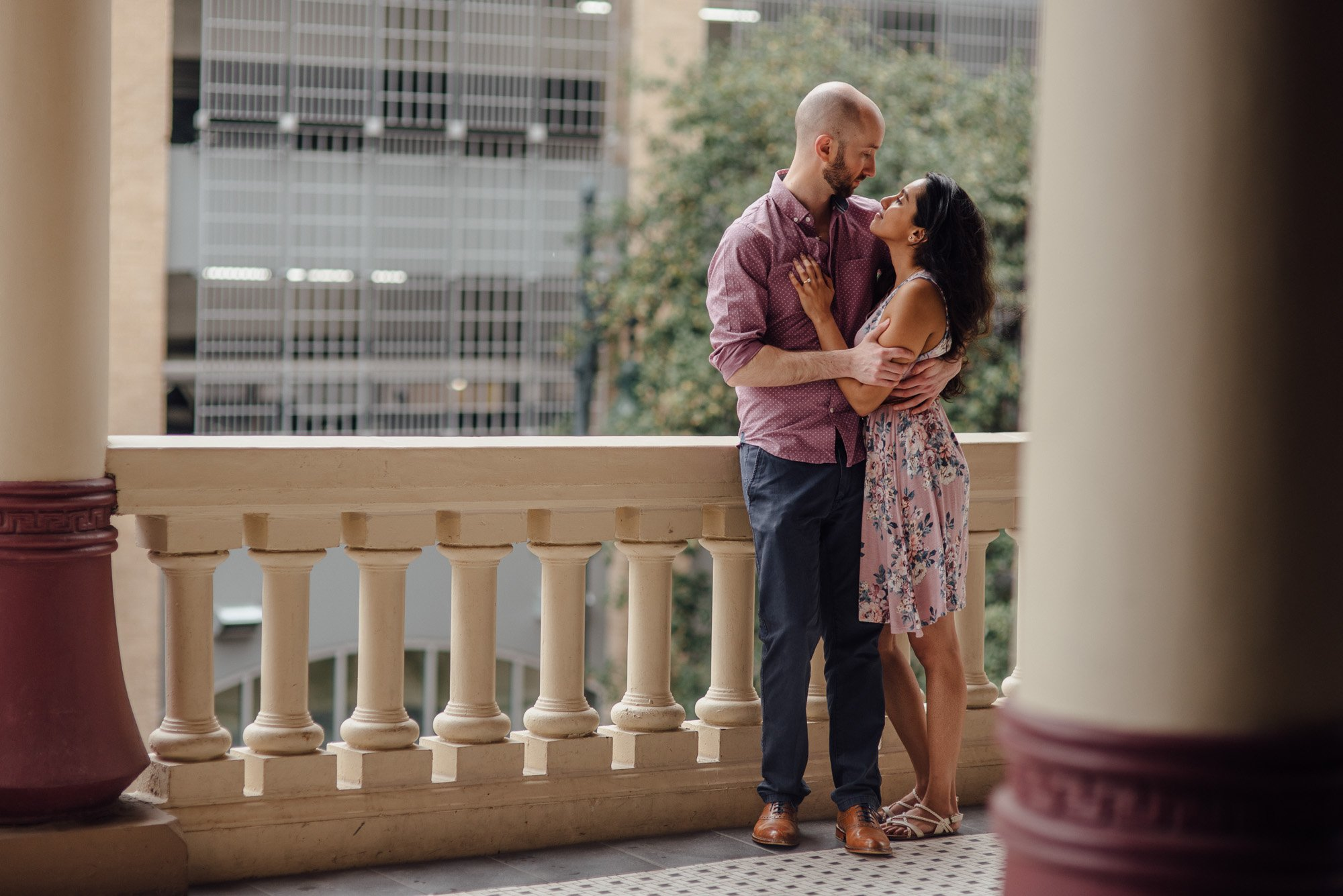 austin engagement photos on the balcony at driskill hotel