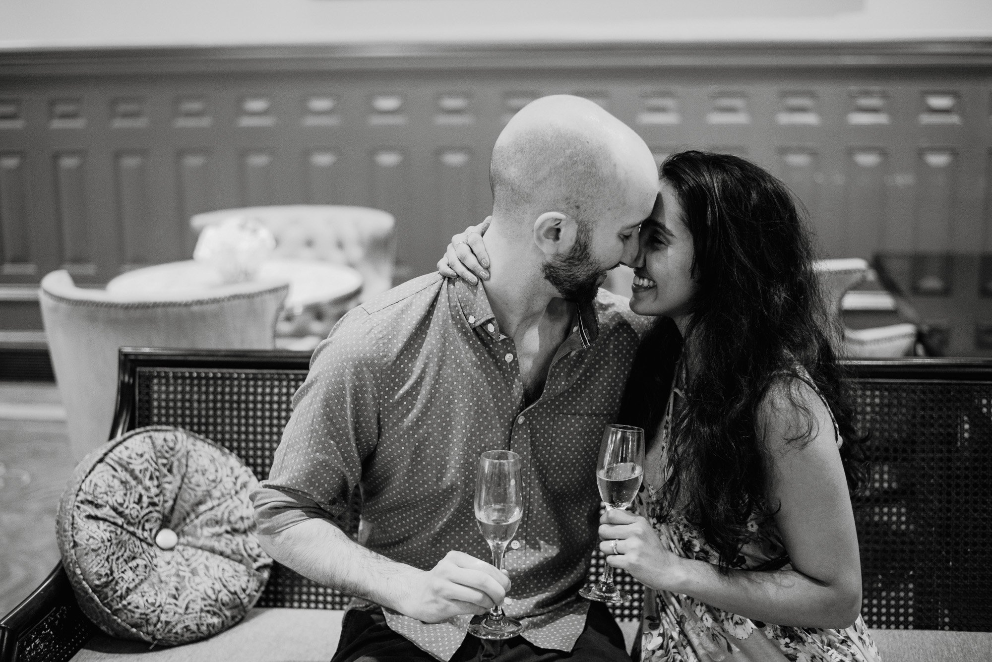 austin engagement session with champagne inside a hotel lobby