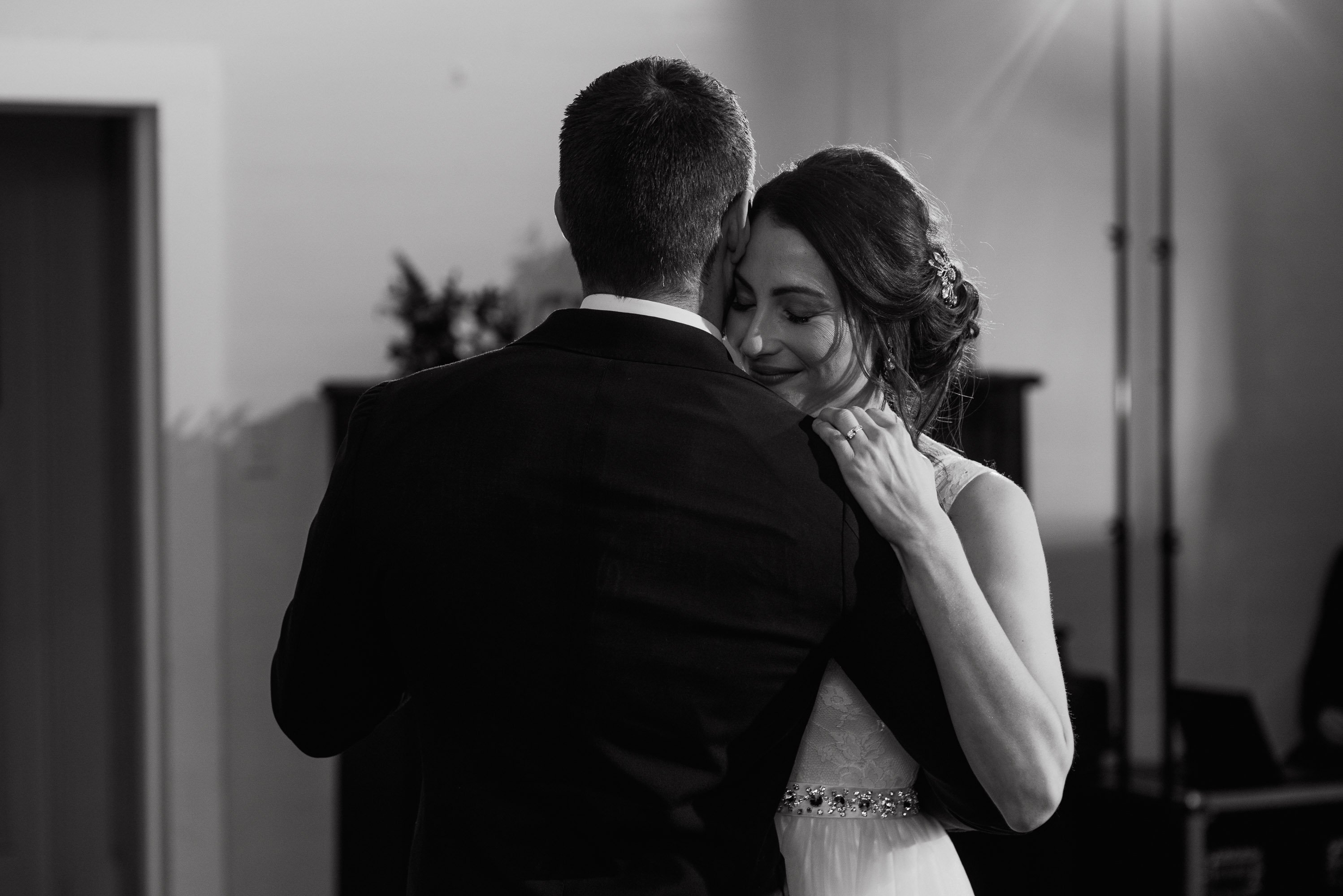 black and white photos of bride and groom at their first dance