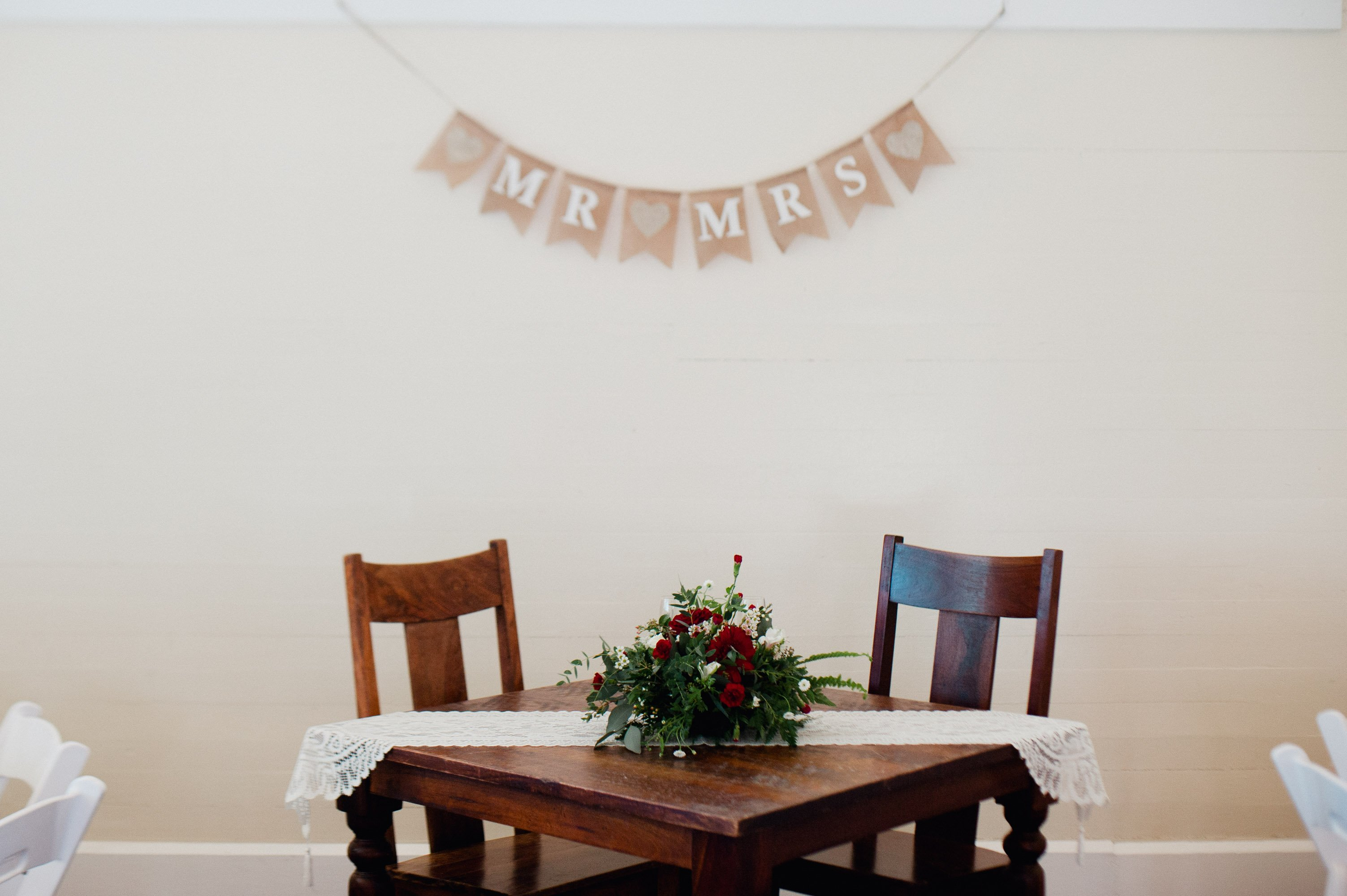 intimate winter wedding details at a sweetheart table
